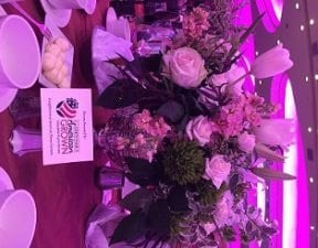 The luncheon bouquets and centerpieces featured beautiful American grown roses, peonies, stock, tulips, lilies, protea, Bells of Ireland, alstromeria, bupleurum, dianthus, freesia, lisianthus, ranunculus, viburnum, waxflower, ferns, leatherleaf and curly willow.