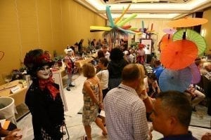 """During the """"Cirque du Fleur"""" themed Sylvia Cup Design Competition during SAF Amelia Island 2015, D Damon Samuel, AAF, AIFD, PFCI, NAFD, NMF, of the Bill Doran Company in Omaha, Nebraska, in costume and makeup, welcomed attendees and the general public to watch the contestants in action. See photos from last year's Sylvia Cup on Flickr."""