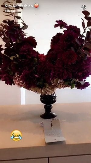 """After receiving sympathy flowers from Chrissy Teigen to commemorate the """"loss"""" of a mobile device, Kim Kardashian West shared a photo of the flowers with her tens of millions of social media followers."""