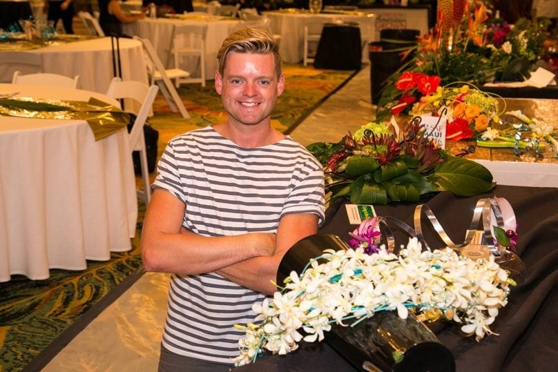 """Derek Woodruff, AIFD, PFCI, CF, owner of Floral Underground in Traverse City, Michigan, won the grand prize. He also placed first in """"Blue Suede Shoes"""" and """"Hawaiian Wedding Song,"""" and third in """"Crying in the Chapel."""""""