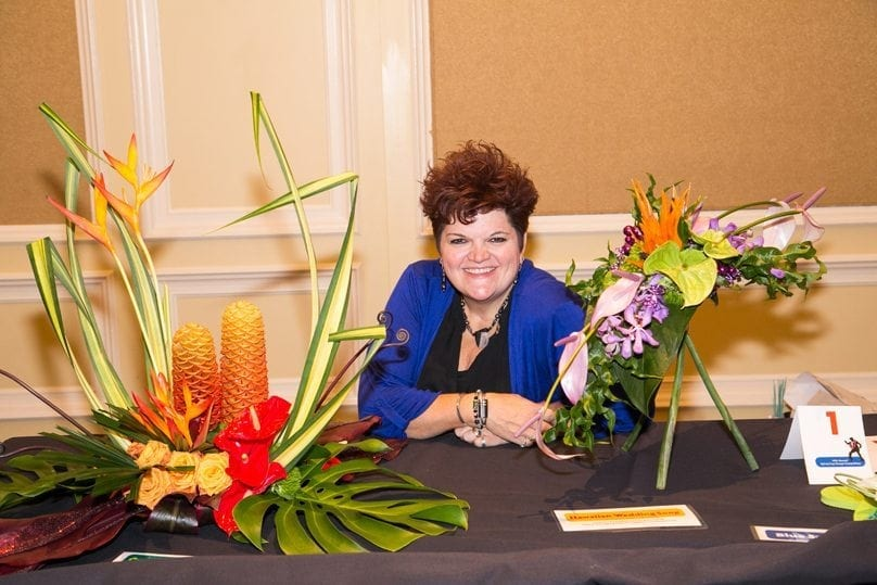 "Sandy Schroeck, AIFD, PFCI, freelance designer, floral educator and product consultant of Trend on Design in Eden Prairie, Minnesota, placed second in ""Crying in the Chapel."""