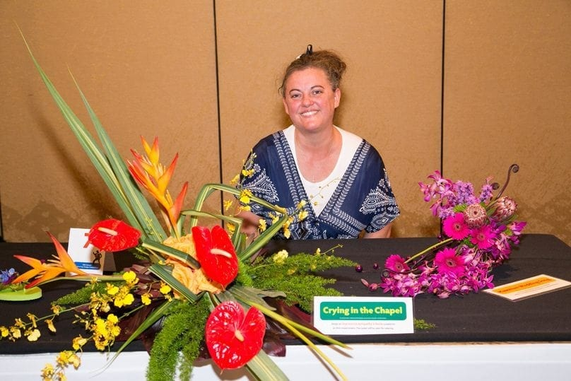 """Tricia Upshaw, AIFD, AMF, of Shirley's Flower Studio Inc., in Rogers, Arkansas and sponsored by the Mid America Design Competition, was second runner-up. She also placed third in """"Hawaiian Wedding Song."""""""