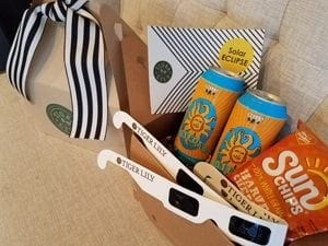 """In Charleston, South Carolina, Tiger Lily handed out themed """"Great Eclipse"""" gift boxes to wedding vendor partners. The boxes, at a cost of $13 each to the ..."""