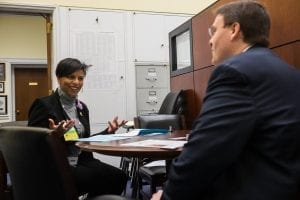 Stacie Lee Banks of Lee's Flower and Card Shop, Inc. in Washington, D.C., discusses industry issues with a member of the staff of Congresswoman Eleanor Holmes Norton.