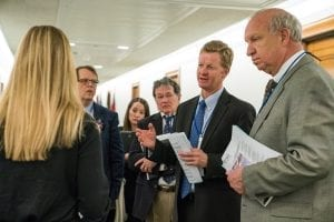Art Van Wingerden of Metrolina Greenhouses in Huntersville, North Carolina, leads the discussion during a meeting in a Capitol hallway — a not uncommon occurrence for busy congressional staffers.