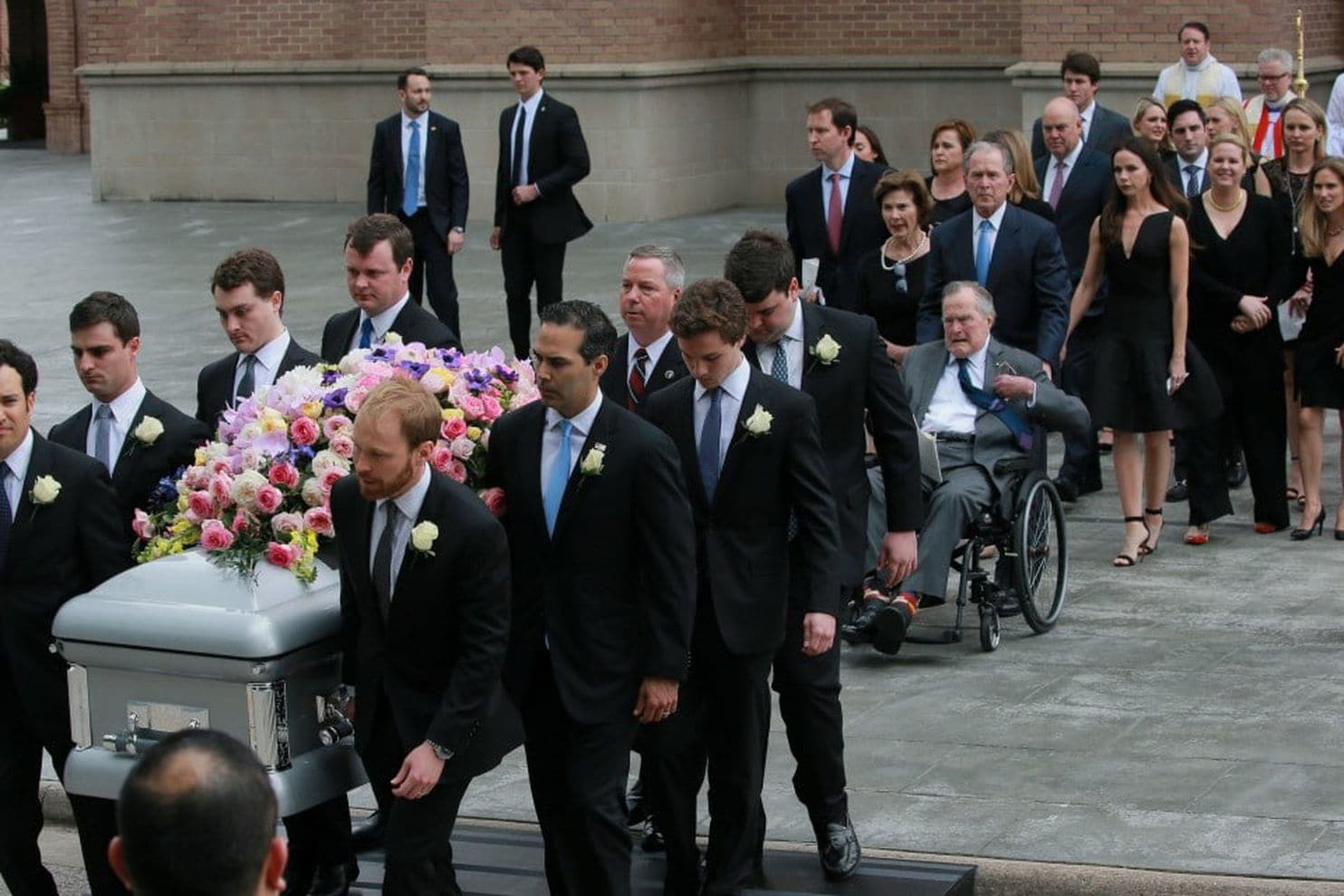 Barbara Bush's eight grandsons carry her casket out of St. Martin's Episcopal Church in Houston on Saturday. In 1990, the former First Lady was inducted into SAF's American Academy of Floriculture.