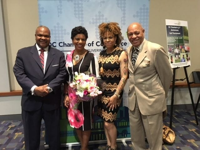 "A segment for ""Good Morning Washington"" focused on Lee's Flower & Card Shop—the business' approach to Mother's Day and also its ties to the community and a recent award presented to co-owner Staci Lee Banks, second from left, who was named Small Businessperson of the Year by the D.C. Chamber of Commerce. Pictured with Lee: Her husband, Jeffrey Banks; sister and business partner Kristie Lee; and father Rick Lee."