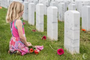 "A young girl reflects at Miramar National Cemetery in San Diego. ""I honestly don't ever see myself doing anything on Memorial Day,"" said Mike Mooney of Dramm & Echter, who helped organize the event."