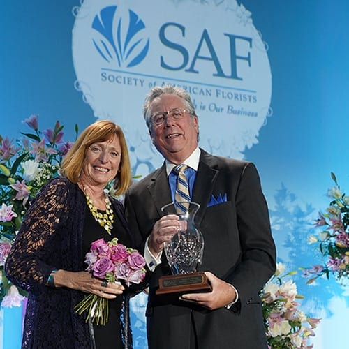 Peter and Sara Moran collecting the Hall of Fame Award in Palm Springs 2018