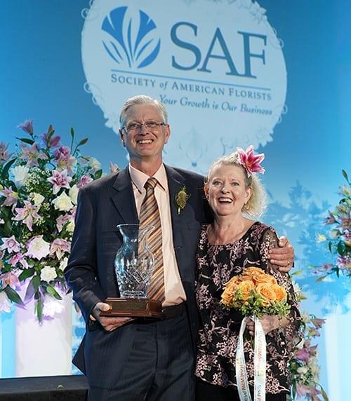Bobbi Echter children collecting the Hall of Fame award on her behalf