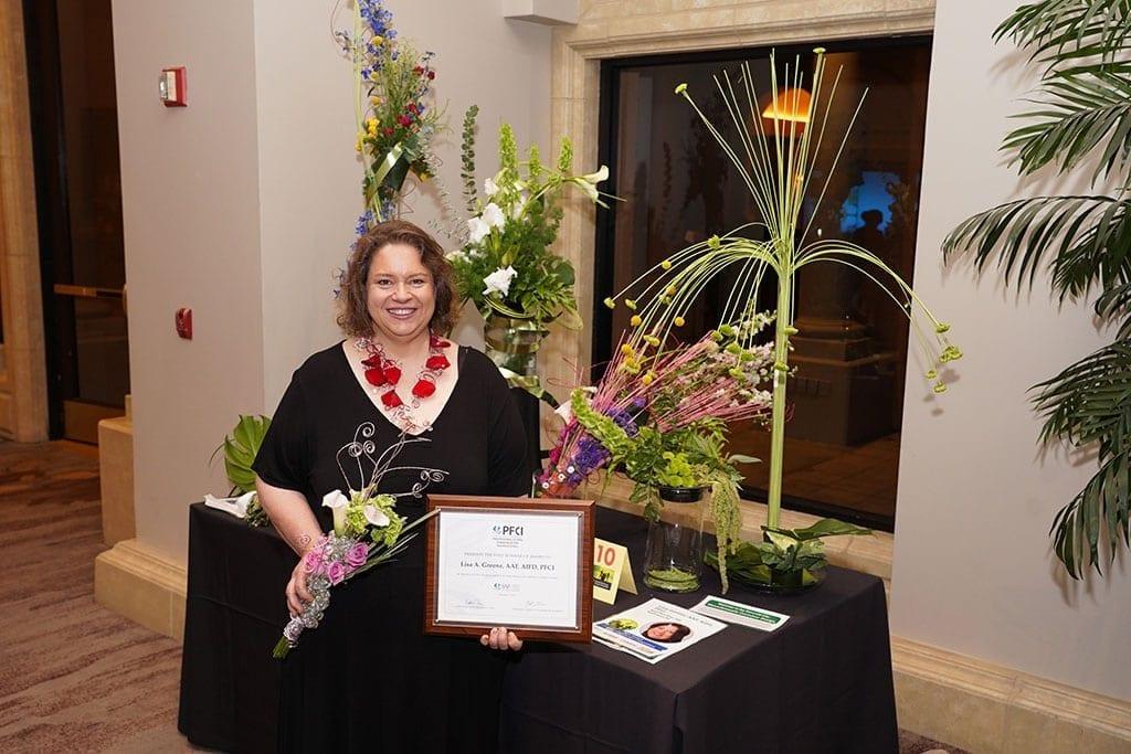 Lisa A. Greene, AAF, AIFD, PFCI, of Beach Plum Flower Shop in Newburyport, Massachusetts was named first runner-up.