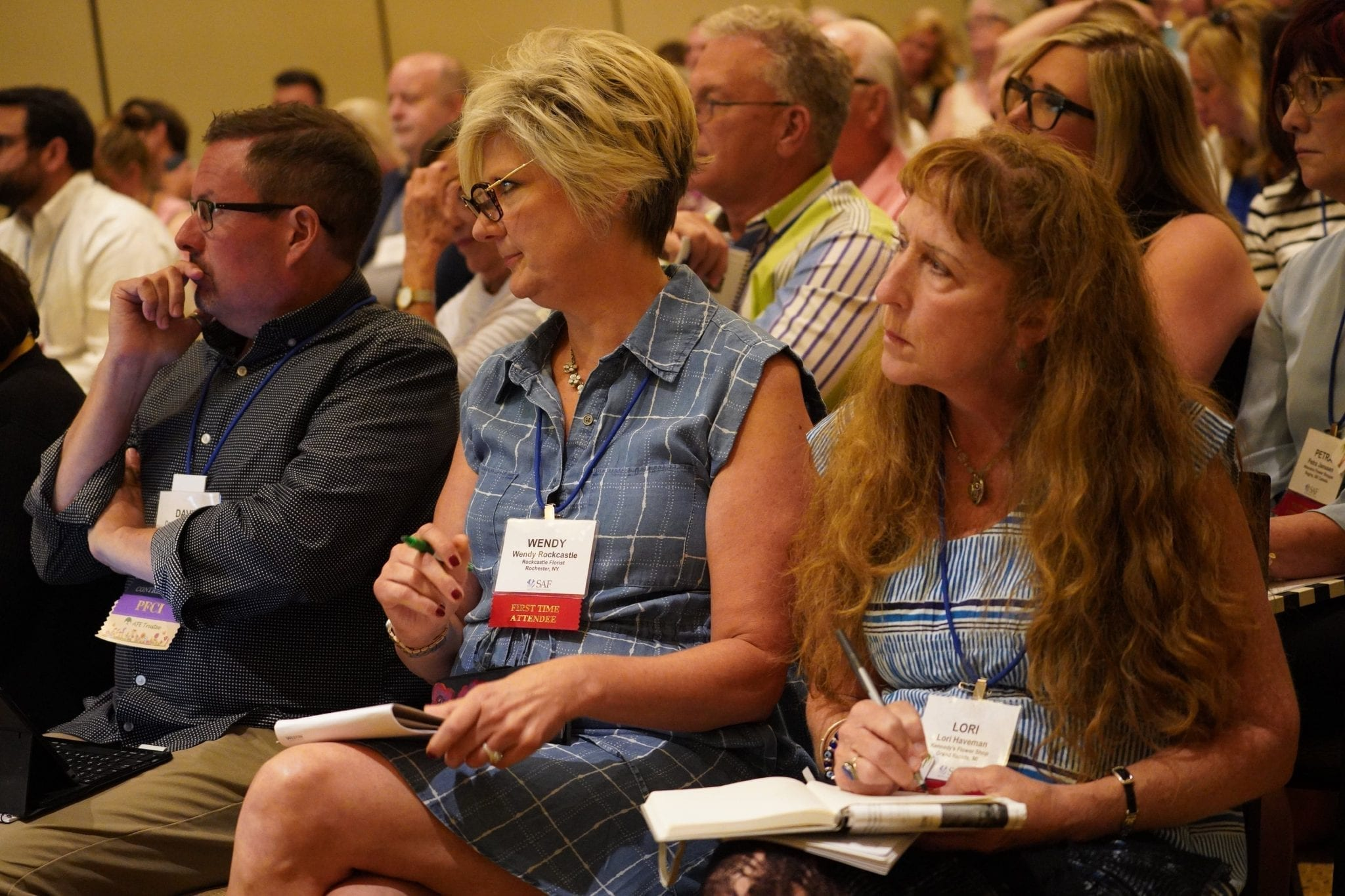 """A packed crowd—including Wendy Rockcastle of Rockcastle Florist in Rochester, New York, and Lori Haveman of Kennedy's Flower shop in Grand Rapids, Michigan—hear about trends and technology coming toward the industry during The Future of the Retail Florist"""" educational session."""