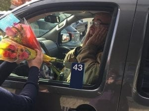 A surprised recipient reacts to the gift of flowers from Flowers, Etc., in Dixon, Illinois