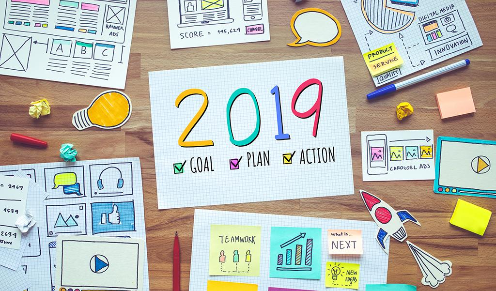 2019 new year resolutions with business digital marketing and paperwork sketch on wood table.analysis strategy concepts ideas