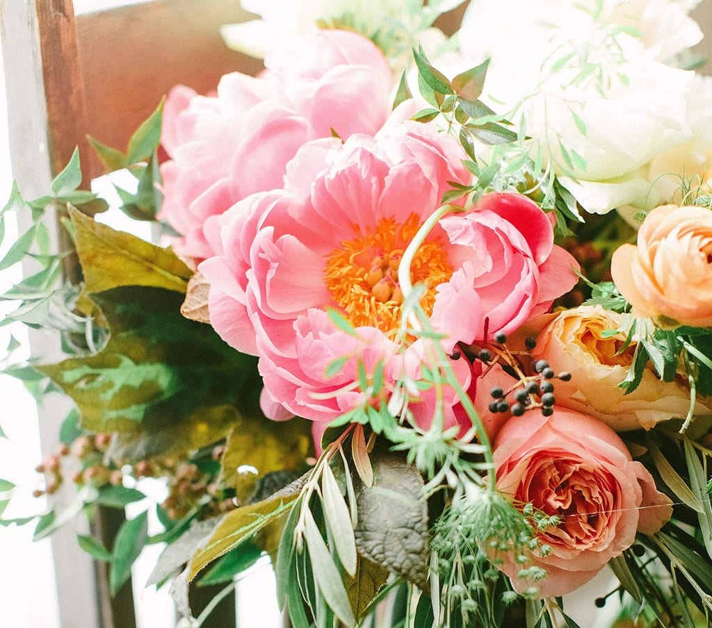 """Living Coral,"" the 2019 Pantone Color of the Year, has many florist fans, including Georgia designer Christy Hulsey, who created this bouquet for a recent wedding. ""It's romantic, whimsical, traditional and mood-evoking,"" she said. ""It fits in all the classic palettes yet provides just a hint of rock 'n roll."" PHOTO BY HALEY SHEFFIELD."