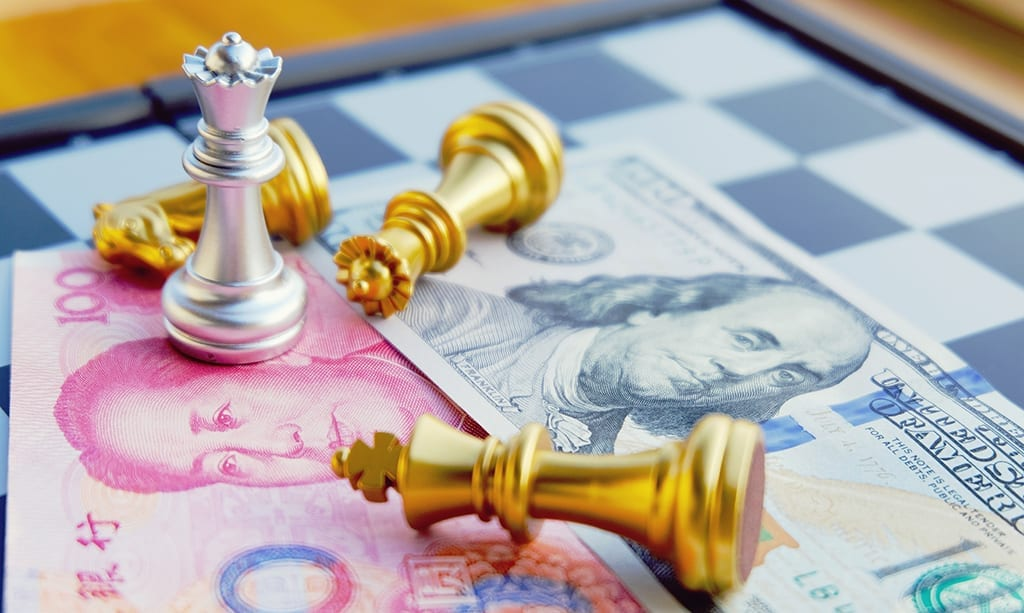 Money game. Chess game. Referring two big countries's conflict. Trade war. Chinese and US bank note under Silver Queen that stands as a winner. International finance concept.