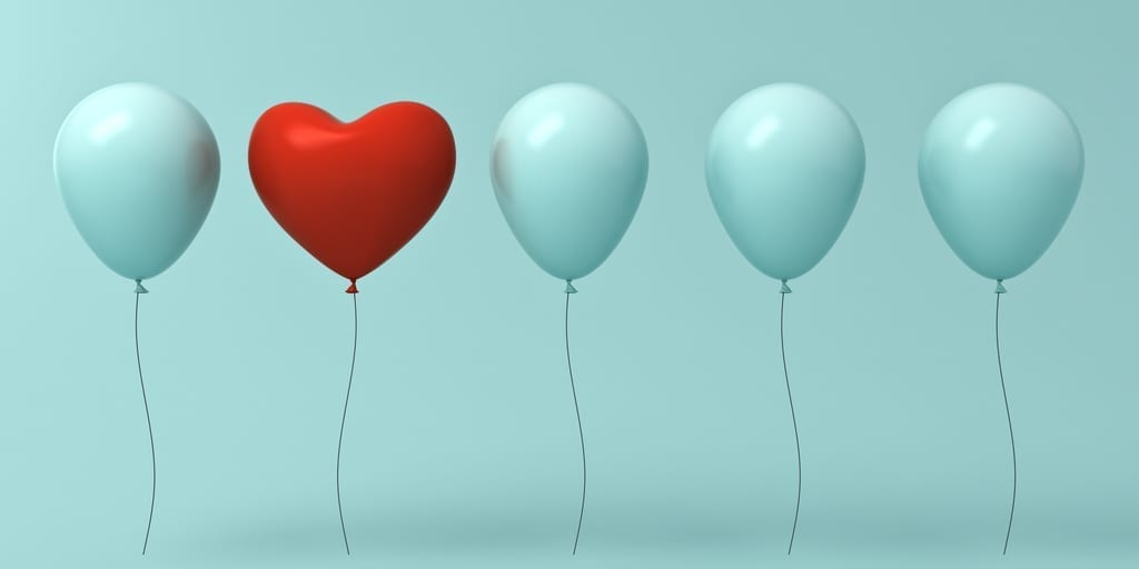 stand out concept blue balloons and with on red heart balloon