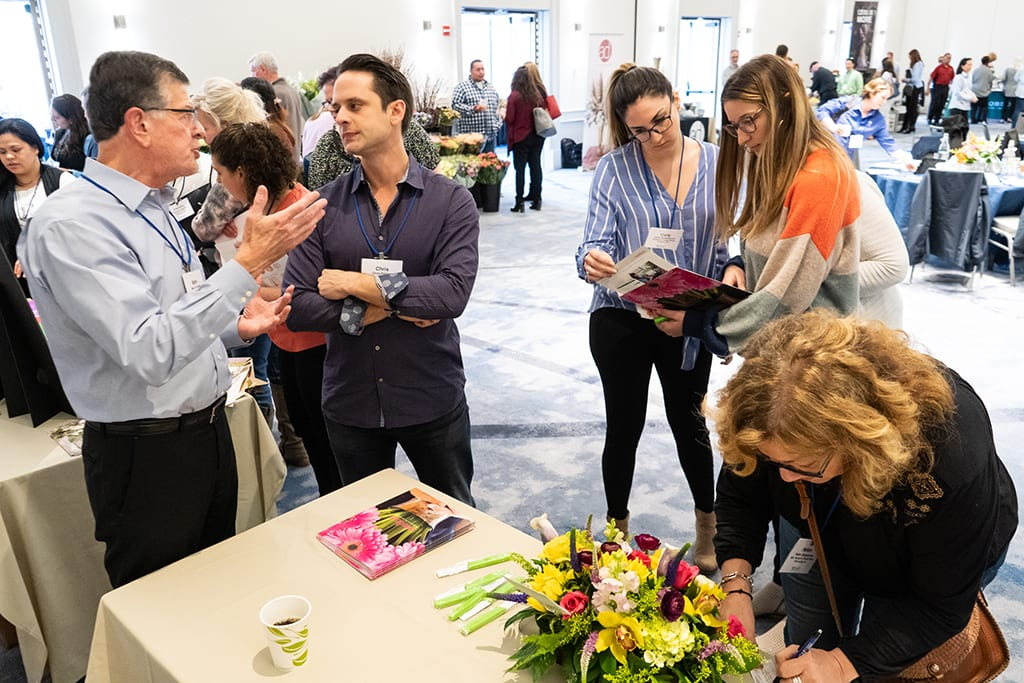 During breaks, attendees had time to visit the vendor stations and talk about new products.